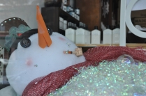 Snowman taking a bath. This was in a window display in Hot Springs, Arkansas.