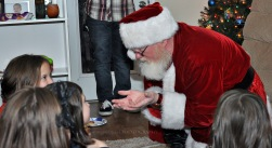 Santa telling the kids a story.