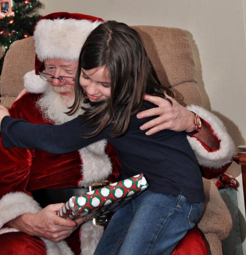 Santa hugs.