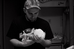 Dad holds his baby for the first time.
