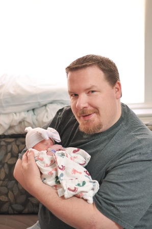 Poppy Jason holds Averey. Gosh doesn't she look tiny?