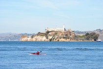 A kayaker on the move around Alcatraz...