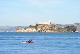 A kayaker on the move around Alcatraz...