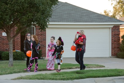 The girls getting a boat load of candy.