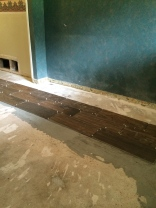 Wood tile starts to go down.
